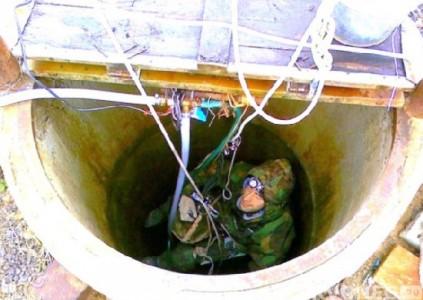 Спуск в ствол шахты при помощи троса