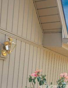 Фото дома, обшитого сайдингом по вертикали