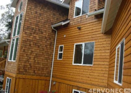 Дом, облицованный деревянным сайдингом
